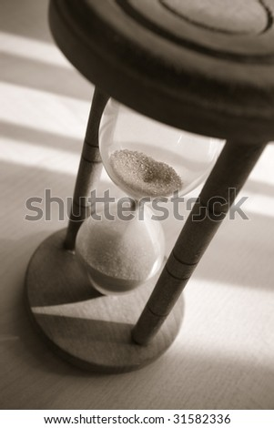 time concept with old hourglass in warm black and white - stock photo