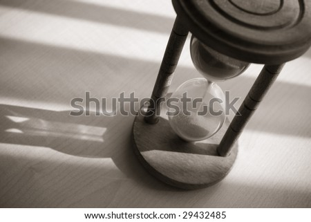 time concept with vintage hourglass - stock photo