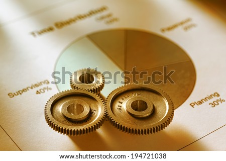 Time distribution diagram with mechanical wrench in toning - stock photo