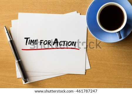 Time for action - handwriting on papers with cup of coffee and pen, business concept