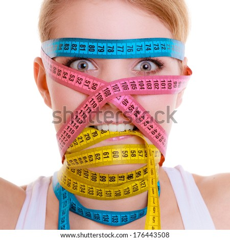 Time for diet slimming weight loss concept. Health care healthy lifestyle. Sport fit fitness woman with a lot of colorful measure tapes around her head. Obsessed girl by your body.  isolated on white - stock photo
