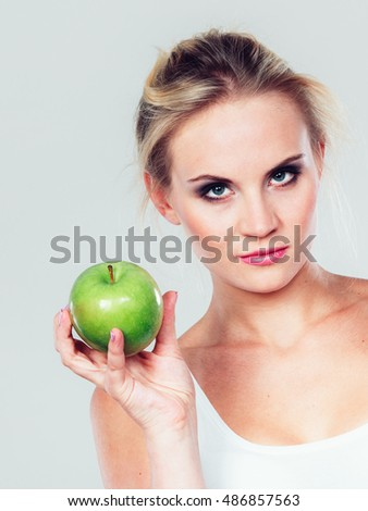 Time for diet slimming weight loss. Health care and healthy nutrition. Fit woman holding green apple fruit.