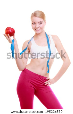 Time for diet slimming weight loss. Health care and healthy nutrition. Young fitness woman fit girl with measure tape and fruit apple isolated on white