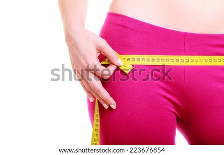 Time for diet slimming weight loss. Health care and healthy nutrition. Young fitness woman fit girl with measure tape measuring her loins isolated on white - stock photo