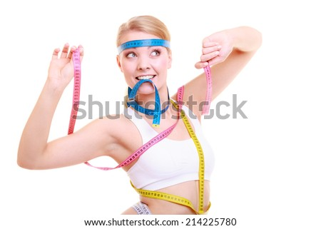 Time for diet slimming weight loss. Health care healthy lifestyle. Fit fitness woman with a lot of colorful measure tapes. Obsessed girl by her body. - stock photo