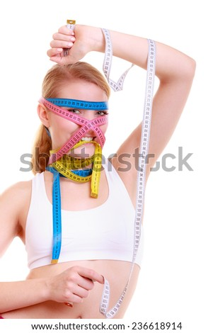 Time for diet slimming weight loss. Health care healthy lifestyle. Fit fitness woman with a lot of colorful measure tapes around her head. Obsessed girl by body.