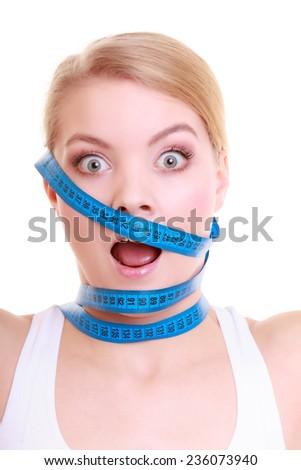 Time for diet slimming weight loss. Health care healthy lifestyle. Fit fitness woman with violet measure tapes around her head. Obsessed girl by body isolated - stock photo