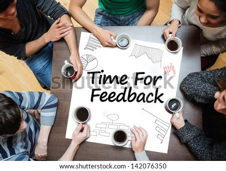Time for feedback written on a poster with drawings of charts during a brainstorm - stock photo