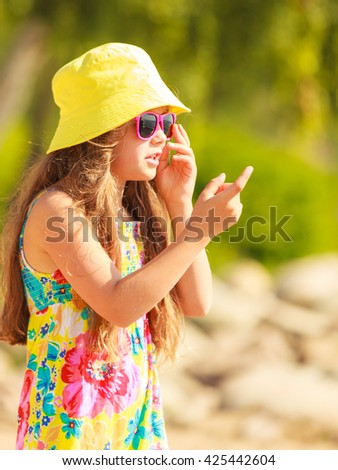 Time for fun. Summer holidays concept. Little funny girl having fun on playground. Child making crazy faces. Enjoyable playful kid outdoors.  - stock photo