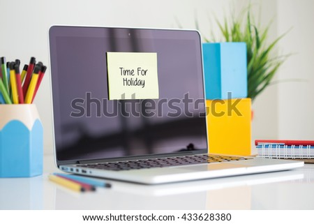 Time For Holiday sticky note pasted on the laptop - stock photo