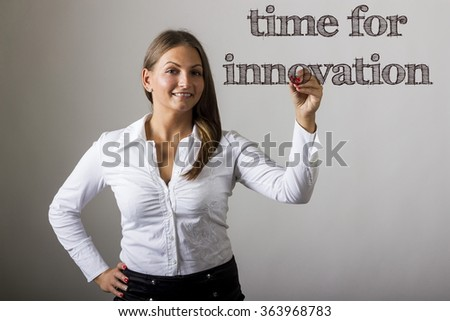 Time for innovation - Beautiful girl writing on transparent surface - horizontal image