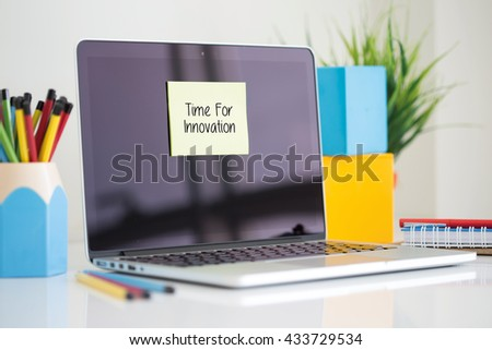 Time For Innovation sticky note pasted on the laptop - stock photo