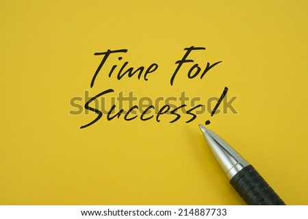 Time For Success! note with pen on yellow background