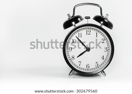 Time for work, Alarm clock with 7 min before 8 o`clock on white background