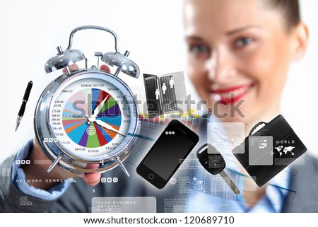 Time in business illustration with clock in hands of businesswoman - stock photo