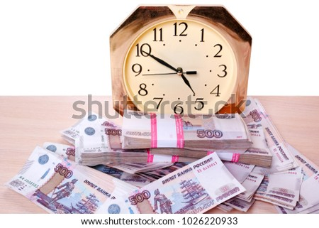 Time is money. Clock and a lot of Russian money