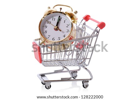 Time is money concept of clock in a shopping trolley isolated on white - stock photo