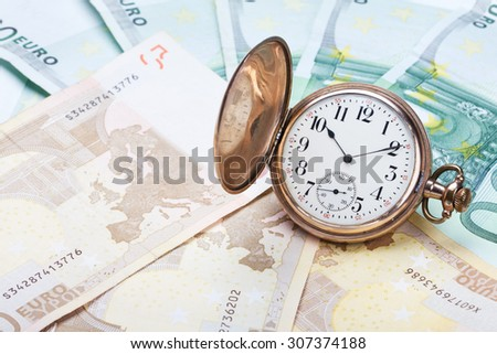 Time is money concept with euros and golden pocket watch. - stock photo