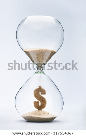 Time is money concept with falling sand taking the shape of a dollar