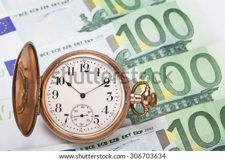 Time is money concept with hundred euros bills and golden pocket watch.  - stock photo