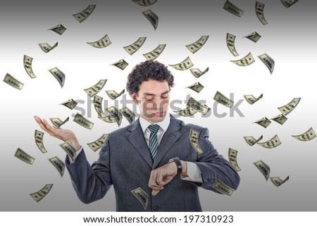 Time is money concept with man looking at watch catching falling bills