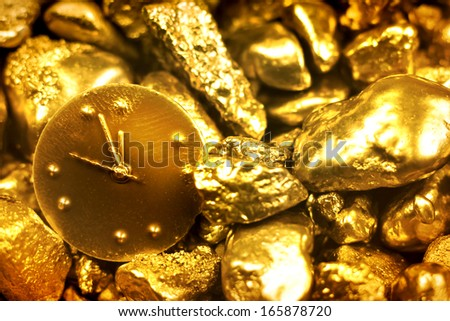 time is money/ gold background with a watch/ christmas background with a watch (tvelve oclock) - stock photo