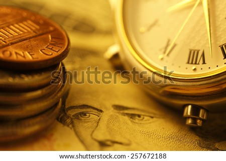 Time is money.  Gold Tone. Close up  - stock photo