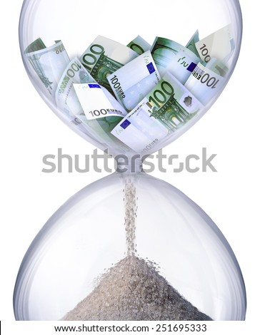 Time is money. Hourglass filled with bills of one hundred euros. Symbolizes time business processes.