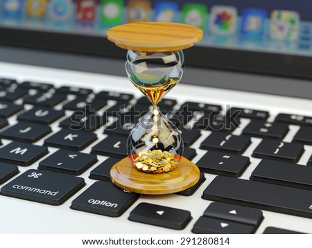Time is money, make money and time management business and technology concept, hourglass with golden coins on laptop keyboard macro view - stock photo