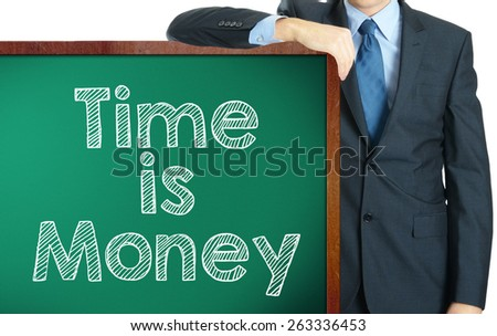 Time is money on blackboard presenting by businessman or teachaer
