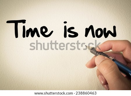 Time is now text write on wall