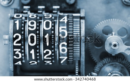Time is running too fast. Two thousands fifteen and a half. The old, mechanical counter, with digits. - stock photo