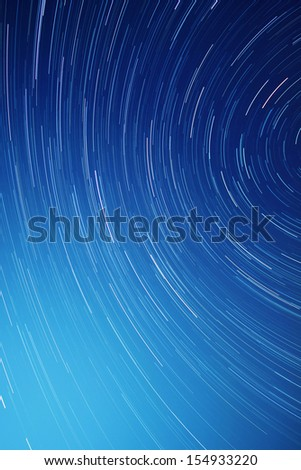 Time lapse image of rotating stars at night - stock photo
