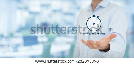 Time management and deadline concept. Businessman with clock watch expecting deadline. Wide banner composition with out of focus office in background.  - stock photo