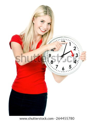 Time management concept. Daylight Saving Time. Young smiling woman with a clock