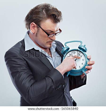 Time management concept. Man hold watch. Isolated background.
