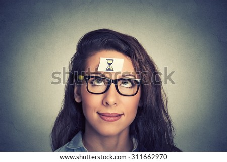 Time management concept young woman with sand clock sign  - stock photo