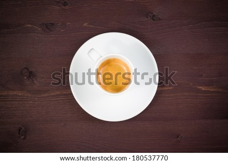 time of coffee break, top of view of one cup of italian espresso coffee on old wood table with space for text - stock photo