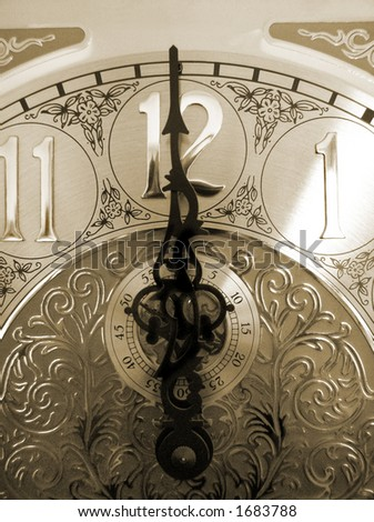 time on a grandfather clock, with an antique look - stock photo