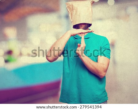 time out man with a paper bag in his head - stock photo