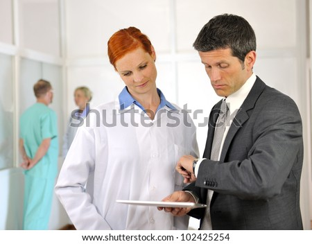 Time pressure and overtime in the hospital - stock photo