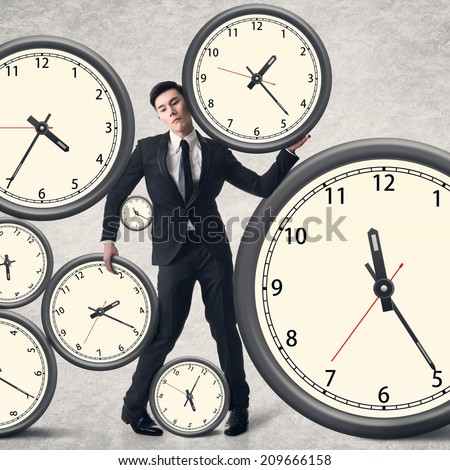 Time pressure concept, Asian business man with many clocks. - stock photo