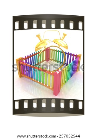 Time protection concept. Gold alarm clock clock closed colorfull fence on a white background. The film strip - stock photo