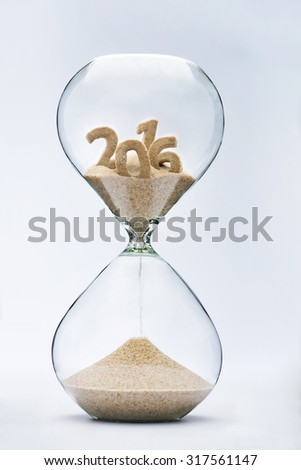 Time running out concept with hourglass falling sand from 2016