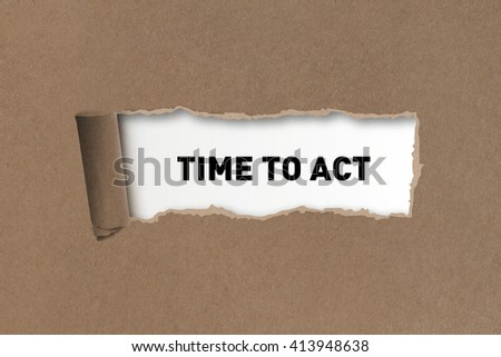 Time To Act written under torn paper. - stock photo