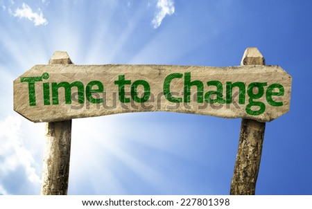 Time to Change wooden sign on a beautiful day - stock photo