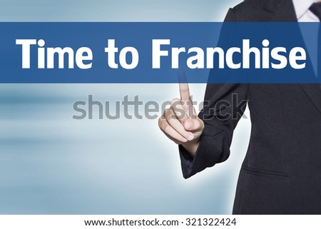 Time to Franchise Business woman pointing at word for business background concept - stock photo