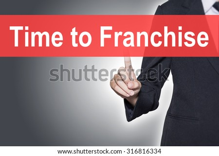 Time to Franchise Business woman pressing hand word on virtual screen - stock photo