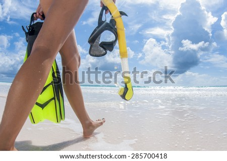 Time to go snorkelling off the beach! - stock photo