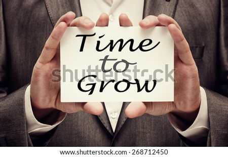 Time to Grow concept in businessman hands - stock photo